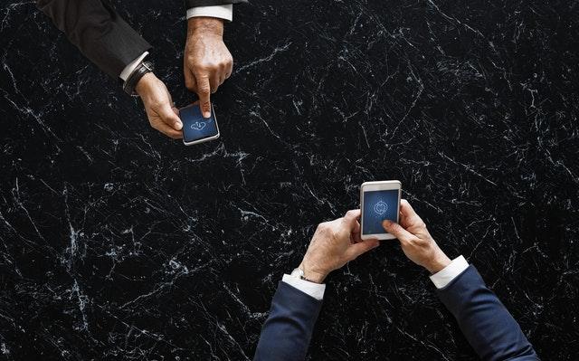 2 men on their phone